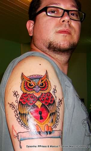 Owl On Burning Candle Tattoo On Arm