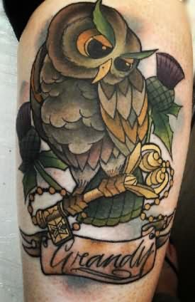 Owl On Golden Key Tattoo