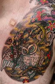 Owl Sitting On Branch Tattoo On Chest