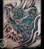 Owl With Blue Eyes Tattoo