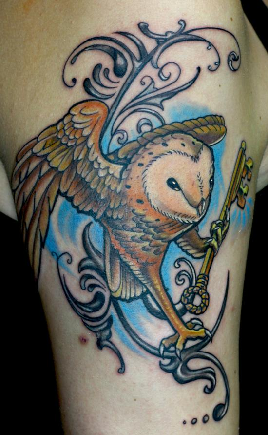 Owl With Golden Key Tattoo On Biceps