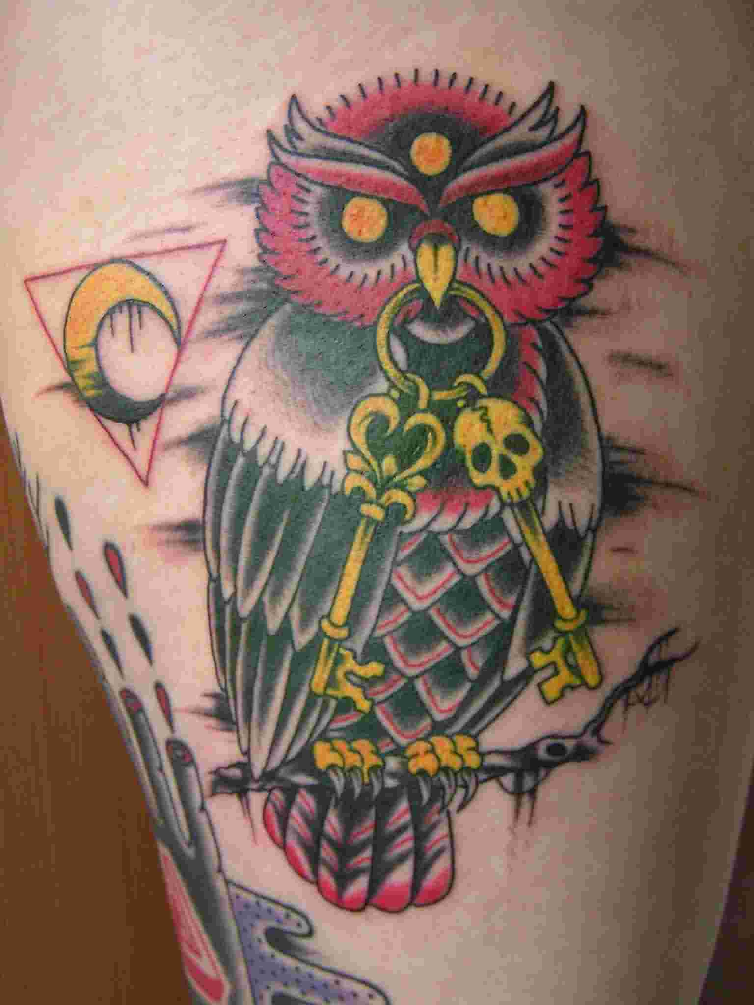 Owl With Keys Sitting On Branch Tattoo