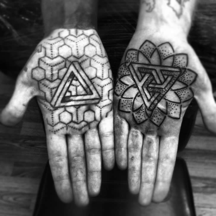 Penrose Triangle And Mandala Tattoos On Hands