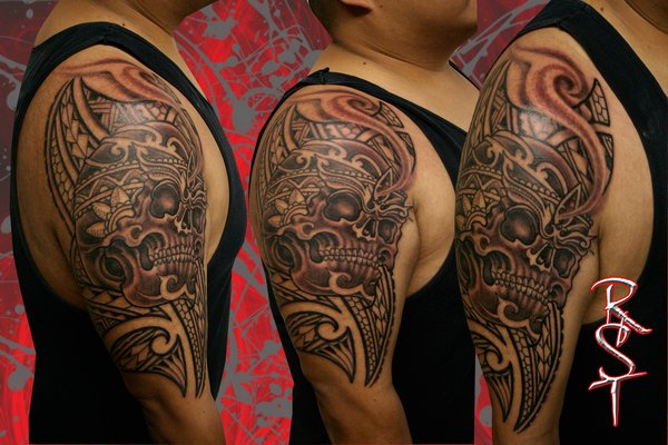 Polynesian And Skull Tattoos On Shoulder