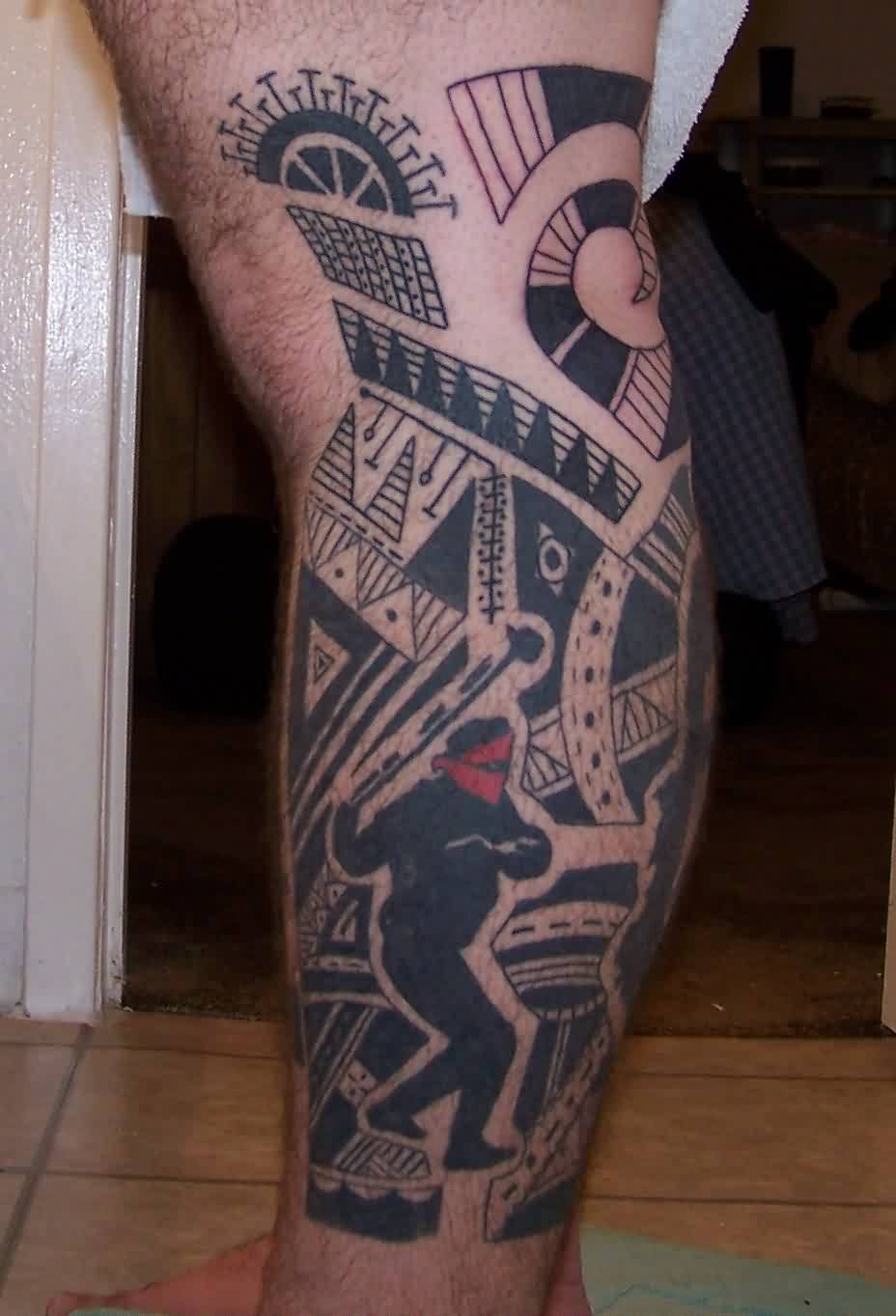 Polynesian And Sportsman Tattoos On Leg