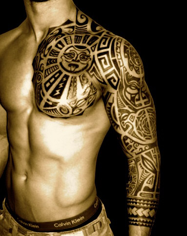 Polynesian Chest And Left Sleeve Tattoos