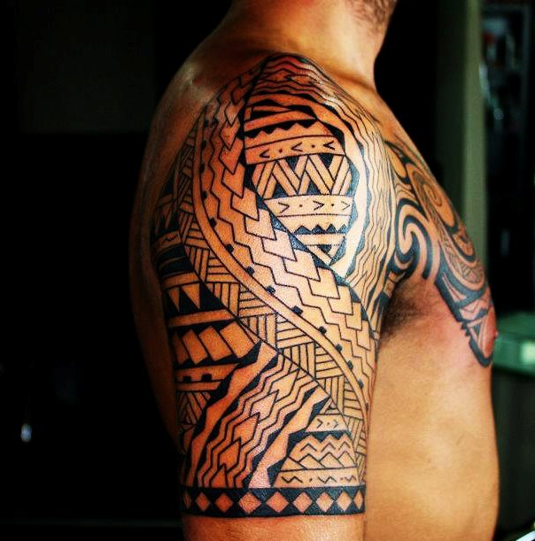 Polynesian Maori Half Sleeve And Chest Plate Tattoos