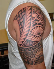 Polynesian Tattoo On Half Sleeve Of Man