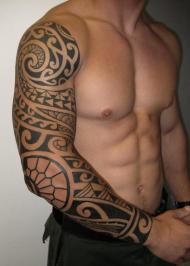 Polynesian Tattoo On Right Sleeve Of Man