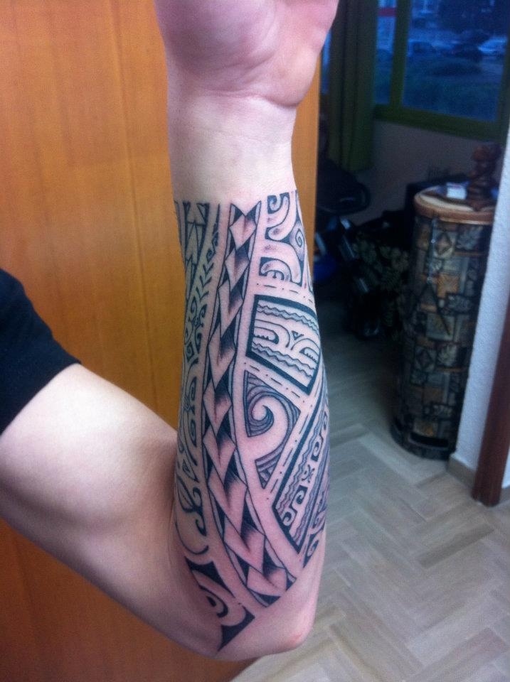 Polynesian Tiki Tattoo On Forearm