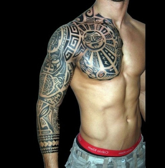 Polynesian Tribal Tattoo On Chest And Right Sleeve