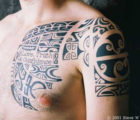 Polynesian Tribal Tattoo On Chest And Shoulder