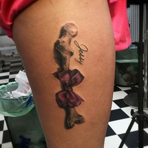 3D Bone With Bow Tattoo On Thigh