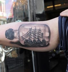 3D Bottle With Pirate Ship Tattoo On Inner Muscles