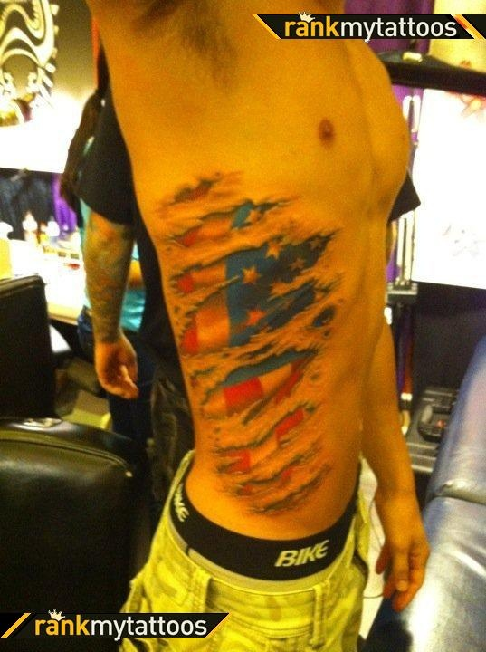 Wonderful American Flag Ripped Skin Tattoo On Side-2
