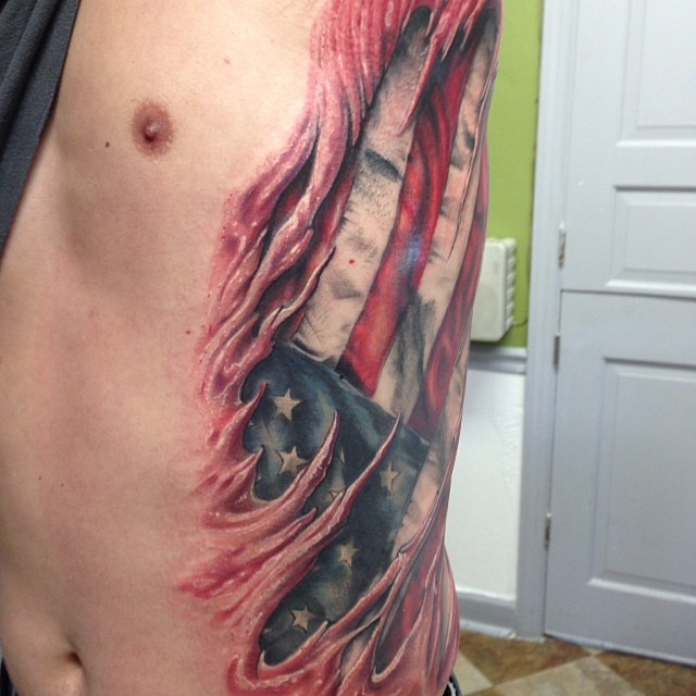 Wonderful American Flag Ripped Skin Tattoo On Side