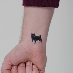 A Very Cute Animal Tattoo On Inner Wrist