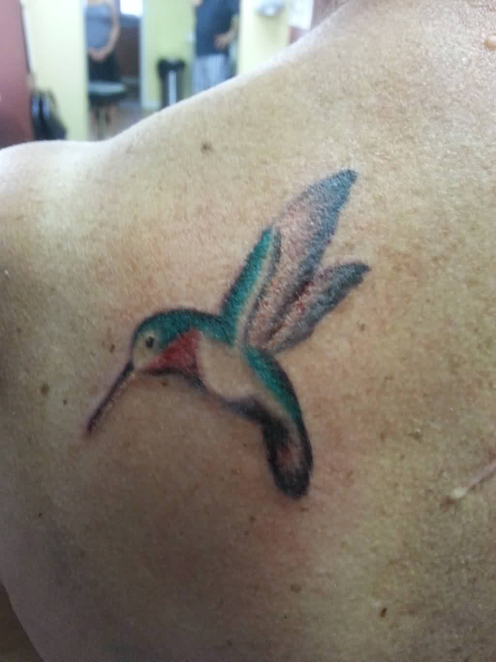 A Very Lovely Watercolor Hummingbird Tattoo