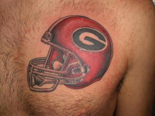 A Very Nice Helmet Tattoo On Chest