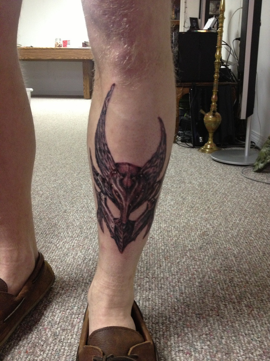 A Very Nice Helmet Tattoo On Leg