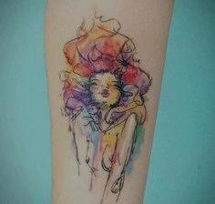 Abstract Watercolor Tattoo On Forearm