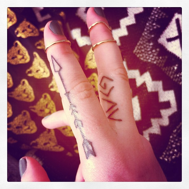 Amazing Black Arrow Tattoo On Side Of Finger