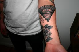 Amazing Eye Pyramid And Rose Tattoos On Lower Arm