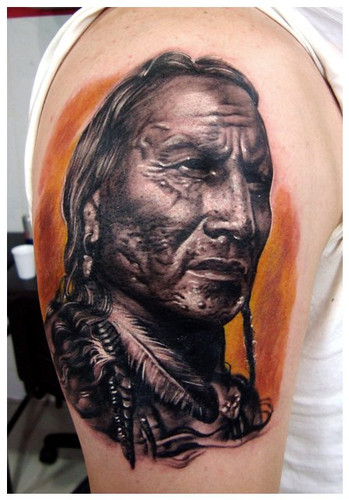 Amazing Grey Ink Ancient Portrait Tattoo On Biceps