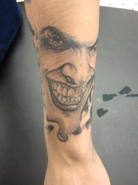 Amazing Grey Ink Joker Portrait Tattoo On Arm