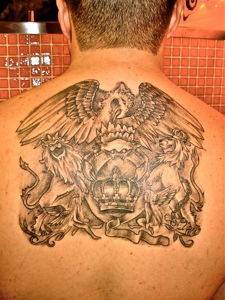 Amazing Grey Ink Queen Band Tattoo On Upperback