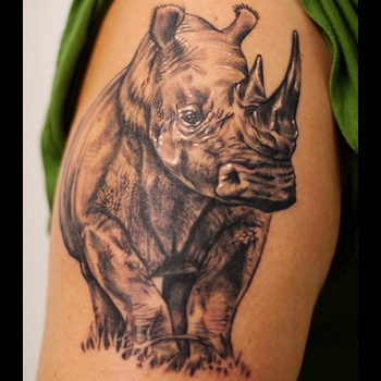 Amazing Grey Ink Rhino Tattoo On Biceps
