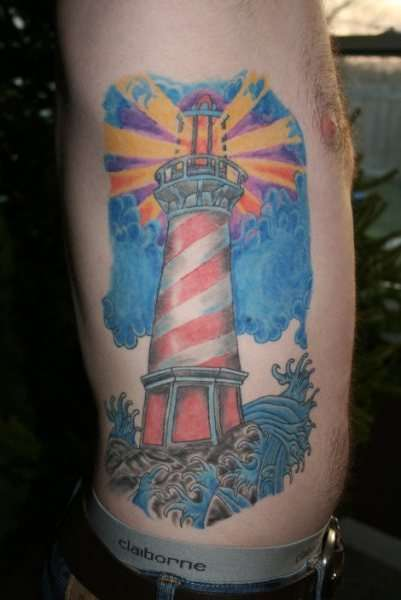 Amazing Lightning Lighthouse Rib Piece Tattoo