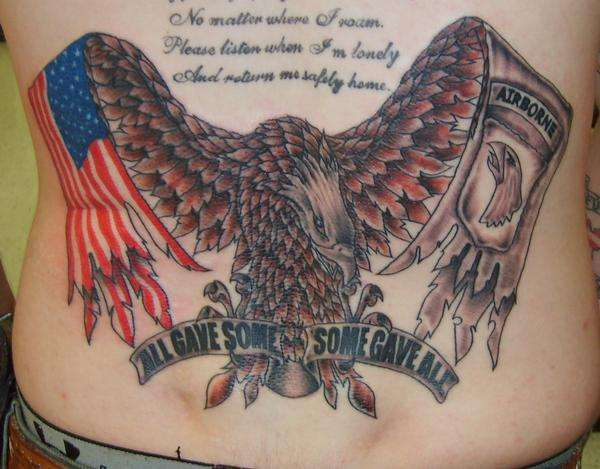 American And Military Tattoos On Lowerback