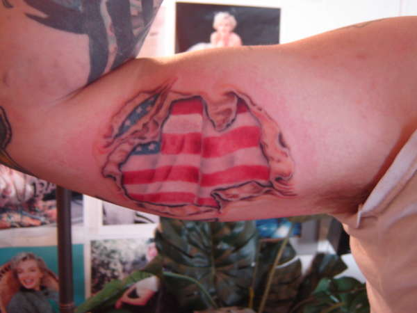 American Flag Rip Skin Tattoo On Inner Muscles