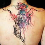 An Abstract Angel Watches Over This Woman From Within This Watercolor Tattoo