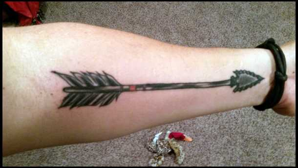 An Old Arrow Tattoo On Forearm