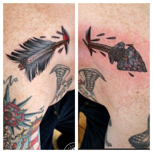 Ancient Ripped Skin Arrow Tattoo