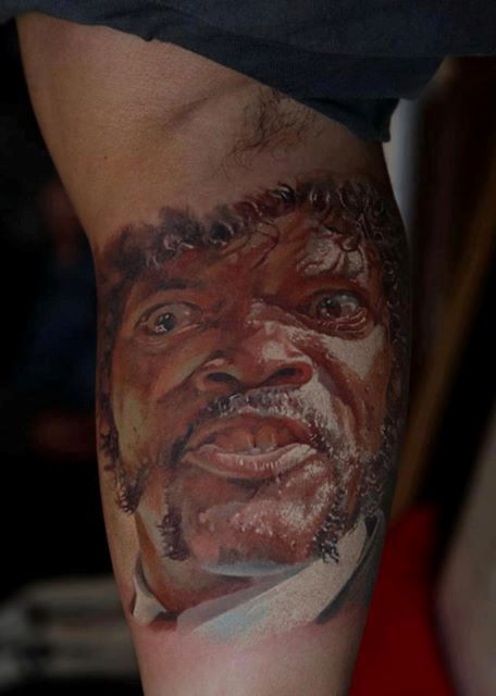 Angry Black Man Face Portrait Tattoo On Muscles