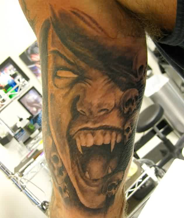 Angry Vampire Portrait Tattoo On Inner Muscles