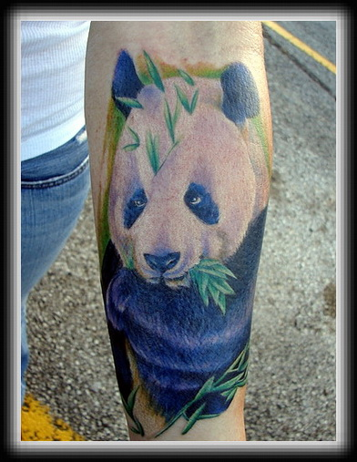 Animal Eating Leaf Tattoo On Arm