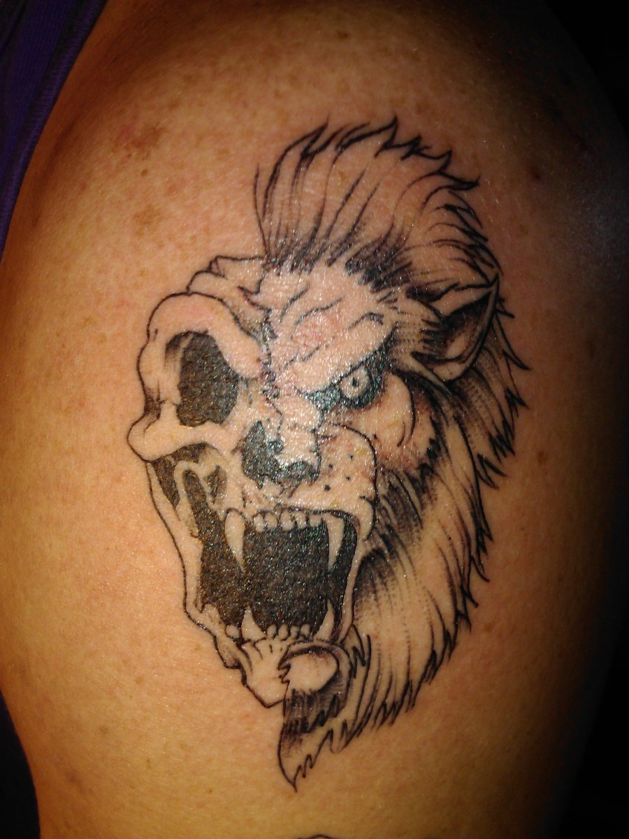 Animal Face Skull Tattoo