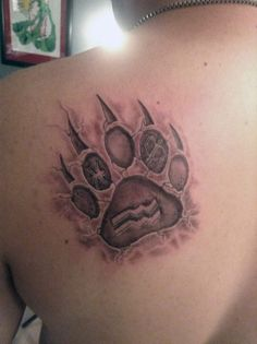 Animal Paw Print With Zodiac Symbol Tattoo