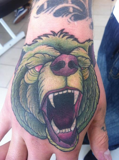 Animal Screaming Face Tattoo On Hand