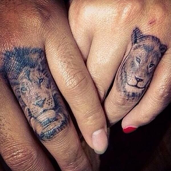 Animal Tattoos On Fingers Of Couple