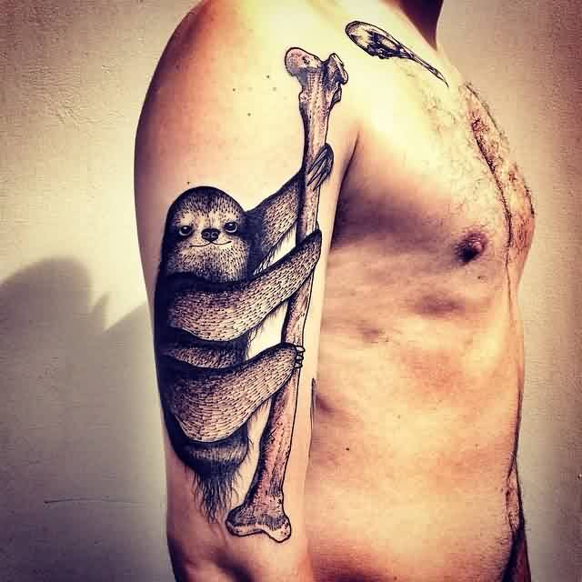 Animal With Long Bone Tattoo On Arm