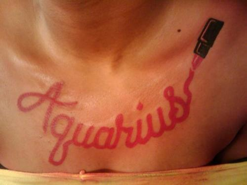 Aquarius Lipstick Tattoo On Chest
