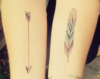 Arrow And Colored Feather Tattoos