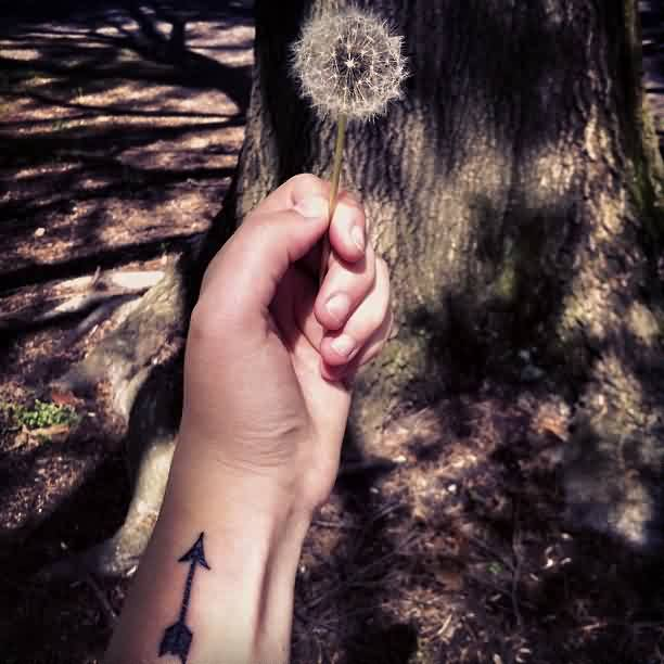 Arrow Tattoo And Dandelion In Hand