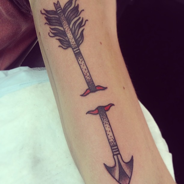 Arrow Through Skin Tattoo
