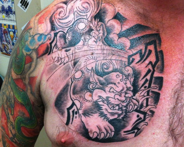 Asian Animal Tattoo On Right Chest